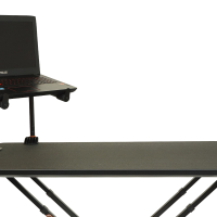 Two Tier Laptop Stand positioned in the left corner